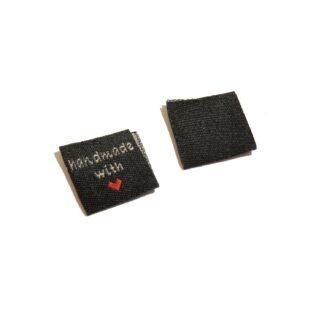 tygmärke fyrkant 2x2cm (4x2) svart